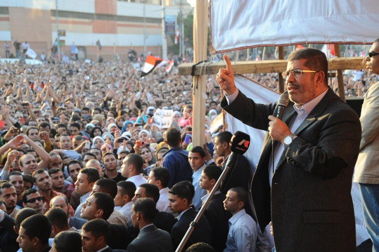 Egypt's President Mohamed Mursi speaks to supporters in front of the presidential palace in Cairo November 23, 2012. (Egyptian Presidency/Handout/Reuters)