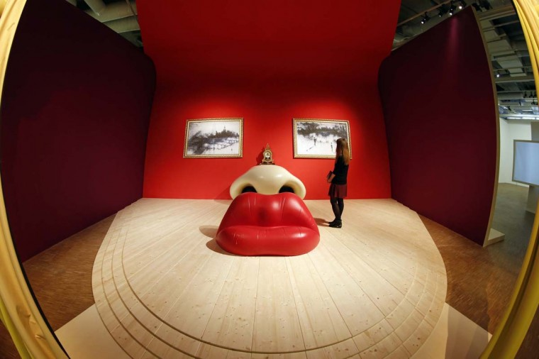 "A visitor looks at the Rita Mae West room by Spanish artist Salvador Dali during a media visit to the exhibition ""Dali"" at the Centre Pompidou modern art museum, also known as Beaubourg, in Paris November 19, 2012. (Benoit Tessier/Reuters)"