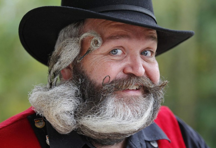 German hairdresser Elmar Weisser, 48, poses with his beard, which is shaped as a stork, during the 2012 European Beard and Moustache Championships in Wittersdorf near Mulhouse, Eastern France, September 22, 2012. Weisser, who won the World Beard and Moustache Championship in 2011, ranked second in the freestyle category of the European championships. (Vincent Kessler/Reuters)