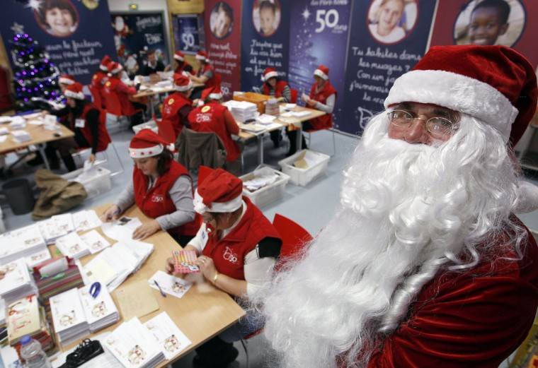A postal employee dressed as Santa Claus poses for the opening day of the Santa Claus secretariat in Libourne post office, southwestern France. Since 1962, they have operated as one of the postal addresses for mail sent to Santa Claus written by children from 160 countries, which celebrates its 50th year, and replied to 1,400,000 letters and 180,000 emails during the 2011 Christmas holiday season. (Regis Duvignau/Reuters)
