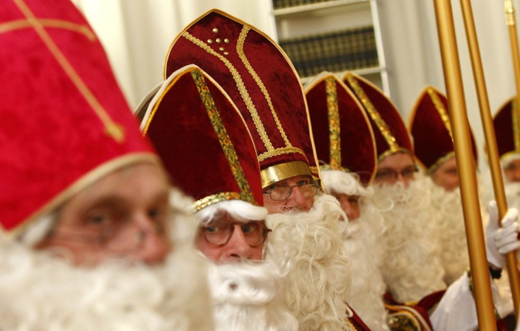 Each year a group of volunteers made up of tax consultants, lawyers, a school director and an orthodontist, dress-up as St. Nicholas to distribute sweets and small presents to children to celebrate St. Nicholas Day. Over two-days, the 24 St. Nicholas' will visit 70 families, social projects and orphanages in Munich with private donations. St. Nicholas Day is traditionally celebrated on December 6. Picture taken November 8. (Michaela Rehle/Reuters)