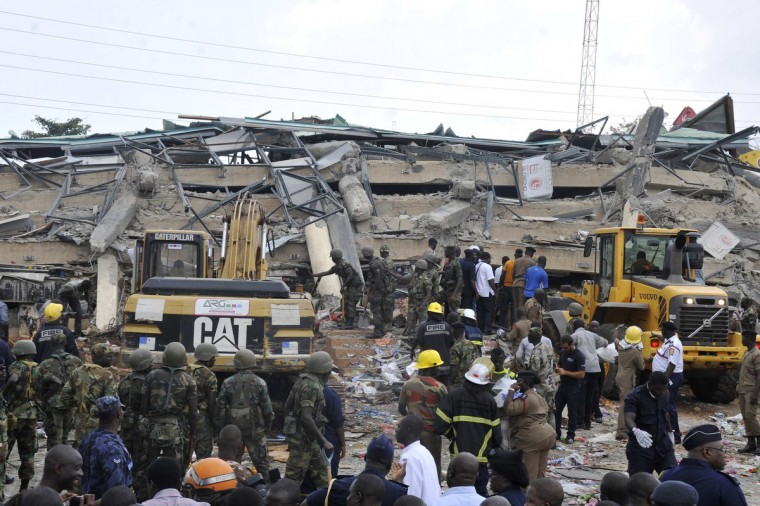 Rescue workers look for survivors from the debris of a collapsed building rented by Melcom Ltd, which runs Ghana's largest chain of retail department stores, in Accra. The four-story building housing a department store in Ghana's capital Accra collapsed on Wednesday, killing at least one person and trapping dozens inside, emergency officials and witnesses said. (Reuters)