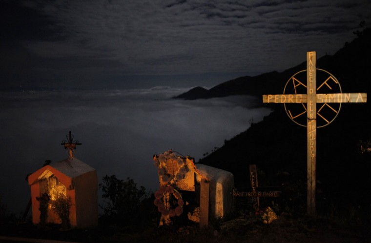 Niches with crosses and candles to celebrate the Day of the Dead are seen on the road to Todos Santos, in the Huehuetenago region, some 280 km (190 miles) west of Guatemala City November 1, 2012. (Jorge Dan Lopez/Reuters)