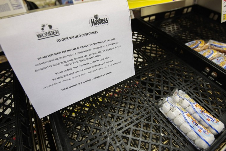 Hanging above a nearly empty shelf at a Wonder Bead Hostess Bakery Outlet in Glendale, Calif., a notice to customers apologizes for a lack of stock due to striking employees. Shoppers tried to stock up on Twinkies, Wonder Bread and other Hostess products after the company announced it was seeking court permission to go out of business. (Bret Hartman/Reuters)