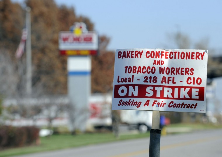 An on-strike sign is posted on the other side of the street from a now-closed Wonder Bread bakery in Lenexa, Kansas. Hostess Brands Inc., the bankrupt maker of Twinkies and Wonder Bread, said it had sought court permission to go out of business after failing to get wage and benefit cuts from thousands of its striking bakery workers. (Dave Kaup/Reuters)