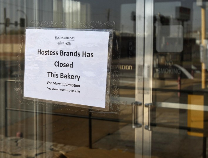 A sign taped onto the door of a Hostess plant in St. Louis announces the locatoin's closure. If Hostess Brands wins court approval to liquidate next week, it is likely to encounter substantial demand for its portfolio of iconic snack cakes and baked goods like Twinkies and Wonder Bread. (Sarah Conard/Reuters)