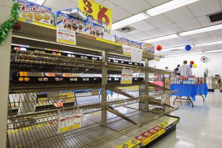 Shelves lay empty at a Wonder Bread Hostess Bakery Outlet in Glendale, Calif. After Hostess Brands Inc, the bankrupt maker of Twinkies and Wonder Bread, has sought court permission to go out of business after failing to get wage and benefit cuts from thousands of its striking bakery workers. The news prompted some shoppers to stock up on the company's iconic snack food products. (Bret Hartman/Reuters)