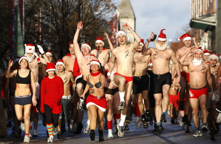 People take part in a half naked 'Santa run' in Budapest on December 12, 2010. (Bernadett Szabo/Reuters)