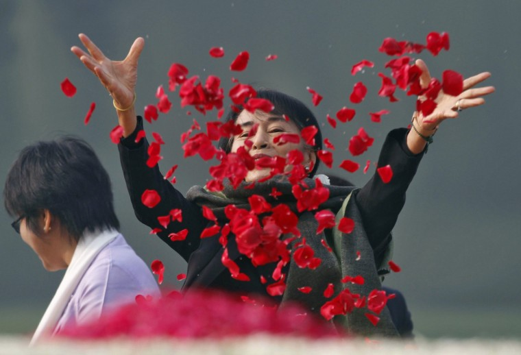 Myanmar's opposition leader Aung San Suu Kyi scatters rose petals at the memorial of India's first Prime Minister Jawaharlal Nehru in New Delhi. Suu Kyi is on a six-day visit to India. (Reuters)