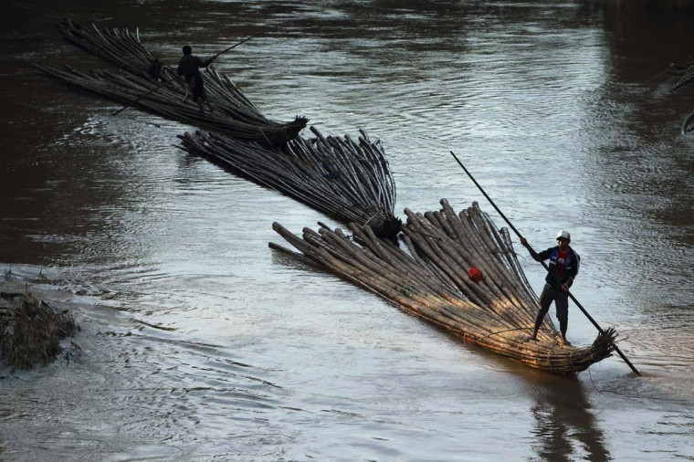 Villagers transport bamboo down river for sell on Ciberang river in Lebak regency, Indonesia's Banten village. (Beawiharta/Reuters photo)