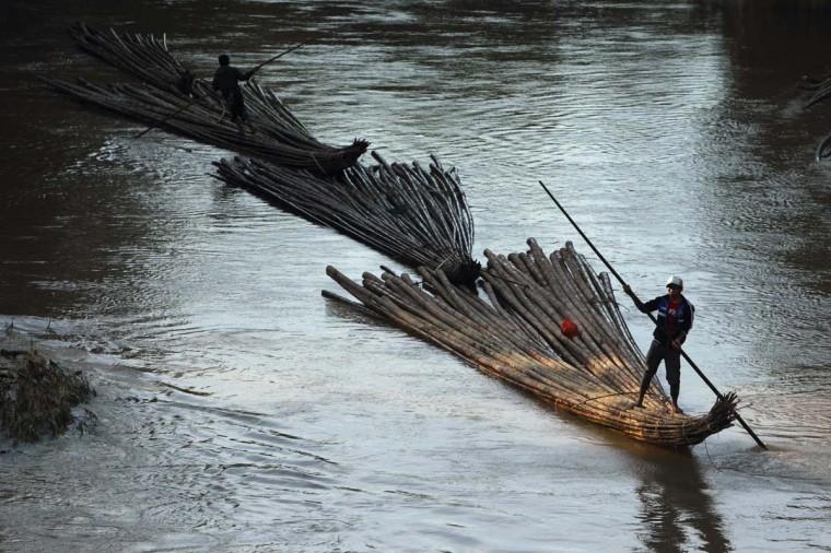 Villagers transport bamboo down river for sell on Ciberang river in Lebak regency, Indonesia's Banten village. (Beawiharta/Reuters photo)