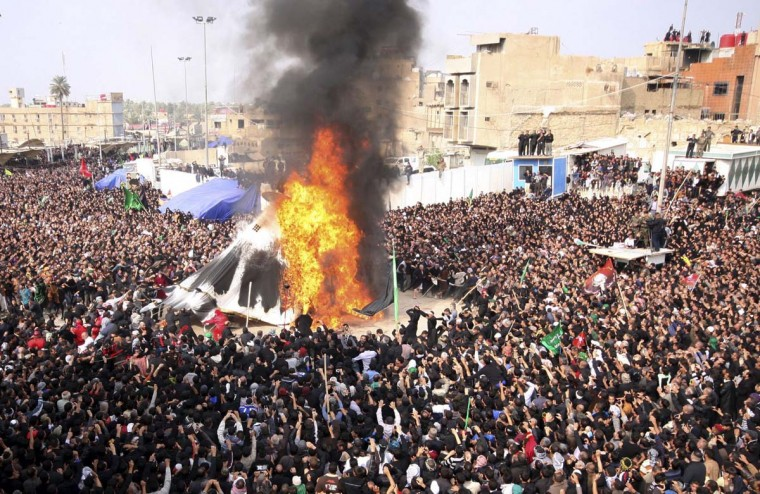 Pilgrims burn a tent during the religious festival of Ashura in Karbala, 50 miles southwest of Baghdad, November 25, 2012. (Mushtaq Muhammad/Reuters)