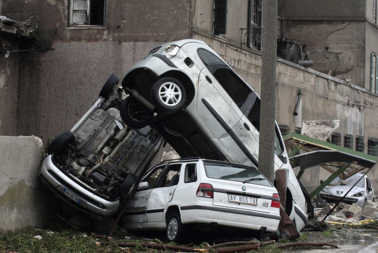 Damaged cars pile up after a storm in Taranto. A violent storm hit a troubled ILVA steel plant in southern Italy on Wednesday, injuring around 20 workers, leaving one missing and adding to disruption at the huge site, which is already caught up in a widening pollution scandal. (Renato Ingenito/Reuters)