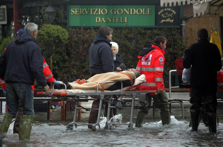 Nurses carry a man on a stretcher in a flooded street during a period of seasonal high water in Venice on Nov. 1, 2012. The water level in the canal city rose to 140 cm (55 inches) above normal, according to a local monitoring institute. (Manuel Silvestri/Reuters)