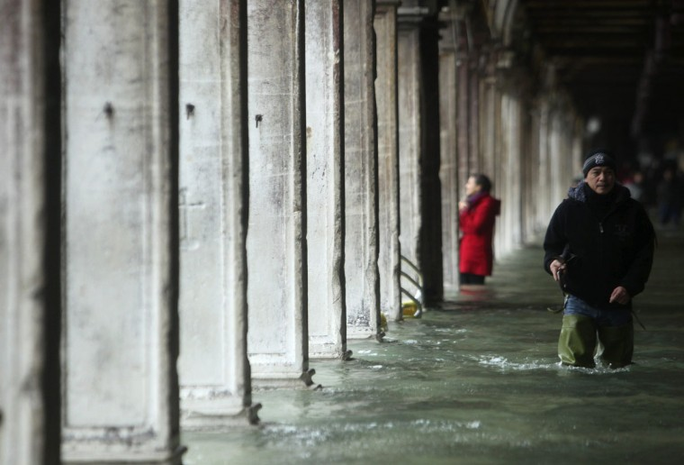 A man walks through a flooded street during a period of seasonal high water in Venice on Nov. 11, 2012. The water level in the canal city rose to 149 cm (59 inches) above normal, according to a local monitoring institute. (Manuel Silvestri/Reuters)