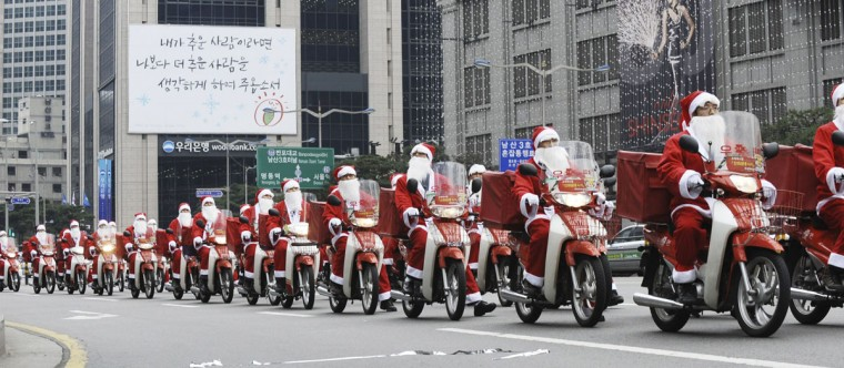 Postmen dressed as Santa Claus ride on their delivery motorbikes during an event to begin their Christmas season service at the Central Post Office in Seoul, South Korea on December 13, 2010. (Kim In-Cheol/Newsis/Reuters)