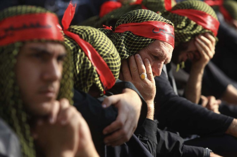 Lebanon's Hezbollah supporters mourn during a ceremony to mark Ashura in Beirut's suburbs, November 25, 2012. (Khalil Hassan/Reuters)