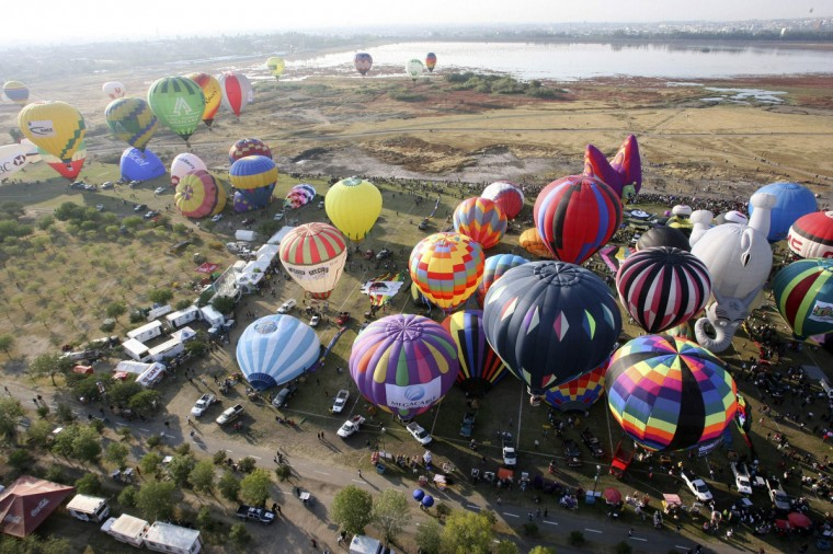 Hot-air balloons are seen during the International Hot-Air Balloon Festival at the Metropolitano park in Leon, in the Mexican state of Guanajuato. (Mario Armas/Reuters)