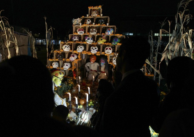 Visitors look at an art installation of skulls at an altar assembled by artists for Day of the Dead celebrations at the National Autonoma University of Mexico in Mexico City October 31, 2012. (Henry Romero/Reuters)