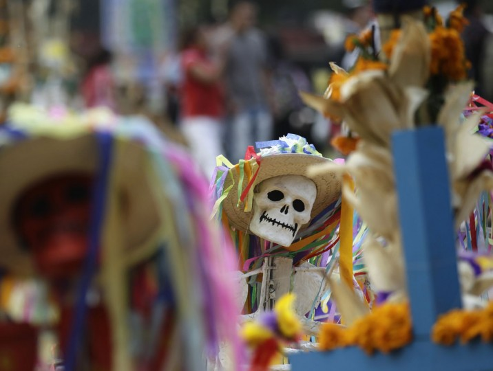 An art installation of skeletons at an altar assembled by artists for Day of the Dead celebrations at the National Autonoma University of Mexico is pictured in Mexico City October 31, 2012. (Henry Romero/Reuters)