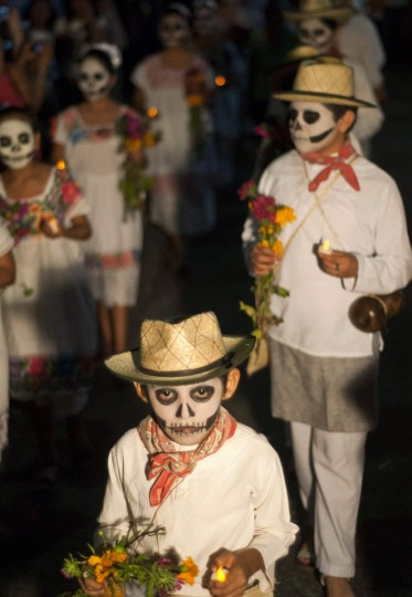 Students with their faces painted as skulls take part in a traditional parade called 'Paseo de las Animas,' or Parade of Souls, in the Mexican city of Merida October 26, 2012. (Francisco Martin/Reuters)