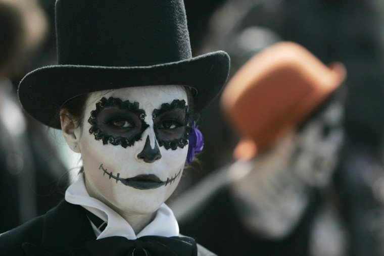 A fine arts student wears make-up during the Catrina's parade in Guadalajara October 26, 2012. Students of fine arts took part in their Catrina's parade as part of the celebrations for the Day of the Dead, local media reported. La Catrina, a popular figure in Mexico known as 'The Elegant Skull.' (Alejandro Acosta/Reuters)