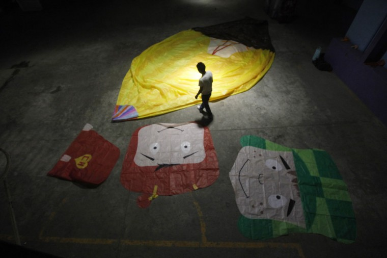 A man prepares a paper balloon before a competition as part of the Day of the Dead celebrations in Milpa Alta November 1, 2012. On the Day of the Dead, Mexicans pay homage to their dead relatives by preparing meals and decorating their graves. (Edgard Garrido/Reuters)