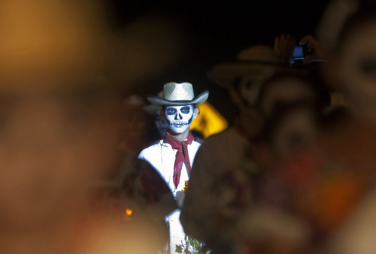 A student with his face painted as a skull takes part in a traditional parade called 'Paseo de las Animas,' or Parade of Souls, in the Mexican city of Merida October 26, 2012. (Francisco Martin/Reuters)