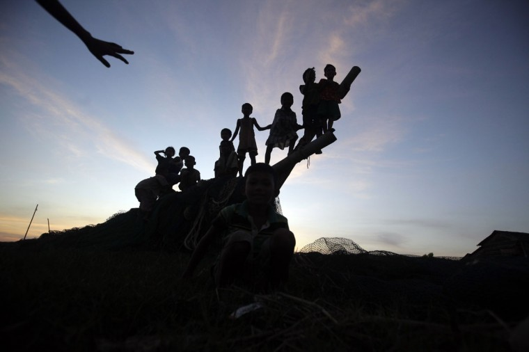 Children play on the bank of the Yangon river in the outskirts of Yangon, Myanmar. (Soe Zeya Tun/Reuters)