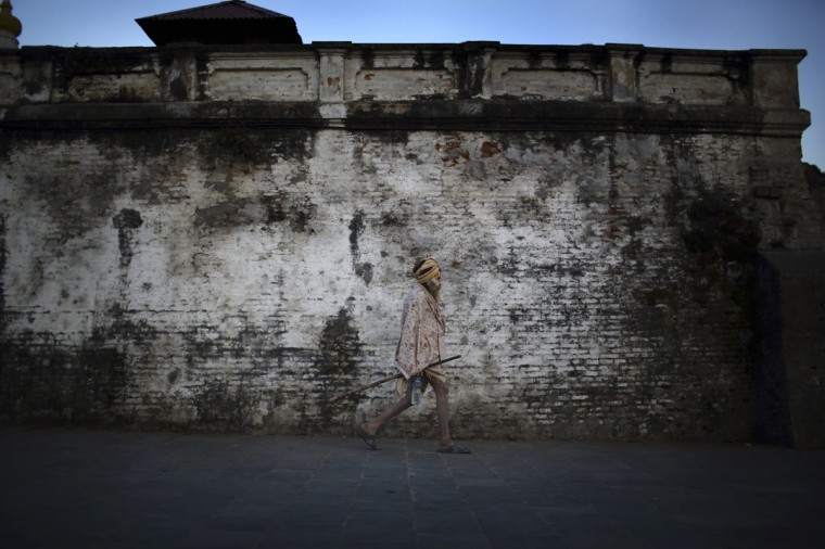 A Hindu holy man, or sadhu, walks along his ashram, a place of retreat, at the premises of the Pashupatinath Temple in Kathmandu. (Navesh Chitrakar/Reuters)