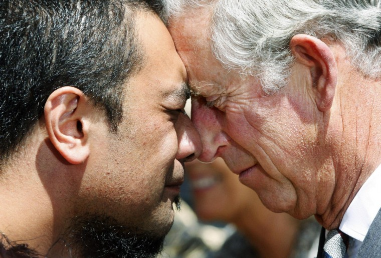 """Britain's Prince Charles (R) receives a traditional """"hongi"""" greeting (or Maori greeting) during a walk along the Wellington waterfront. Britain's Prince Charles and his wife, Camilla, Duchess of Cornwall, are on the last leg of a tour to mark Queen Elizabeth's diamond jubilee. (Kent Blechynden//Reuters)"""
