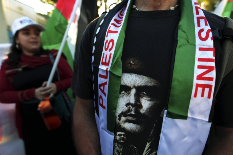 NOVEMBER 20: An activist wears a T-shirt with an image of revolutionary leader Che Guevara during a march towards the United Nations building in Managua. Palestinian residents in Nicaragua and pro-Palestinian activists protested against Israel's military action in Gaza. (Oswaldo Rivas/Reuters)