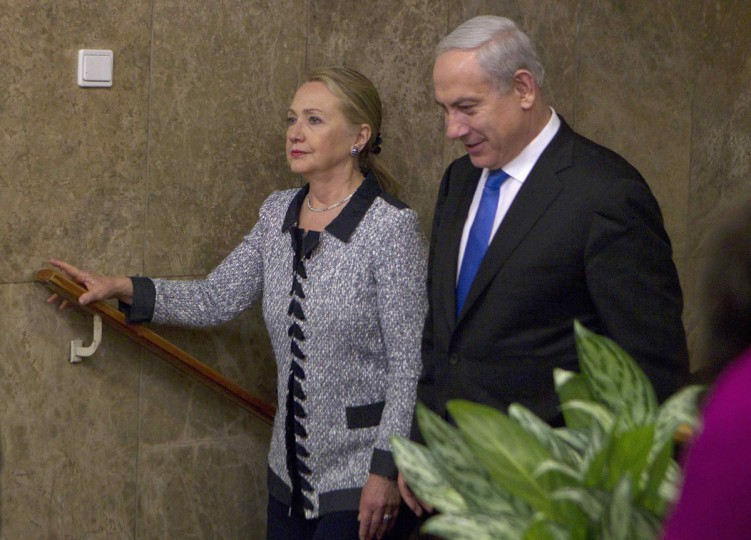 NOVEMBER 20: Israel's Prime Minister Benjamin Netanyahu walks with U.S. Secretary of State Hillary Clinton upon her arrival to their meeting in Jerusalem. The United States signalled on Tuesday that a Gaza truce could take days to achieve after Hamas, the Palestinian enclave's ruling Islamist militants, backed away from an assurance that it and Israel would stop exchanging fire within hours.(Baz Ratner/Reuters)