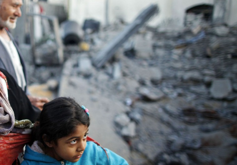 NOVEMBER 20: A Palestinian girl stands next to a relative's house after it was destroyed in what witnesses said was an Israeli air strike in Beit Lahiya, in the northern Gaza Strip. (Suhaib Salem/Reuters)