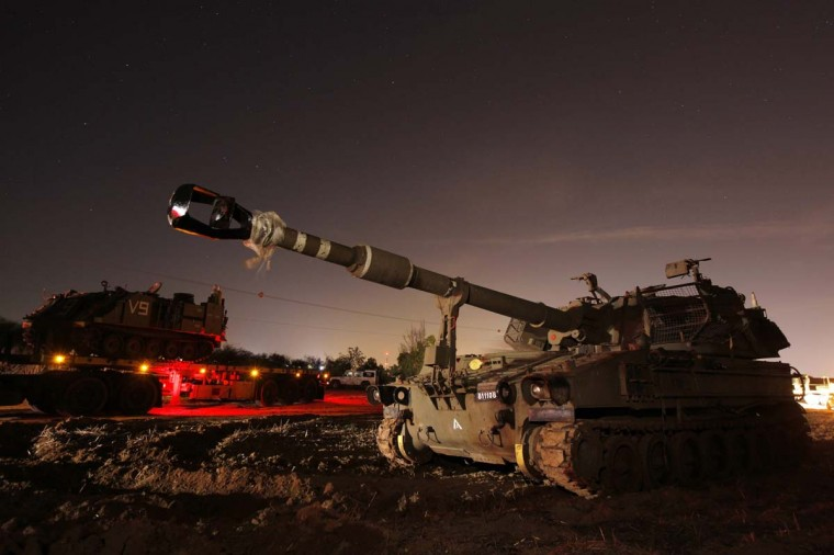 NOVEMBER 15 — A 155mm mobile cannon (front) is seen after it was transported to an area just outside the northern Gaza Strip November 15, 2012. Two rockets fired from the Gaza Strip targeted Tel Aviv on Thursday in the first attack on Israel's commercial capital in 20 years, raising the stakes in a showdown between Israel and the Palestinians that is moving towards all-out war. (Amir Cohen/Reuters)