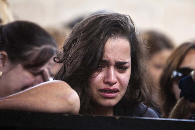 NOVEMBER 16 — A woman cries during the funeral of Itzik Amsalam, who was killed on Thursday after a rocket fired from Gaza landed in the southern town of Kiryat Malachi November 16, 2012. (Nir Elias/Reuters)
