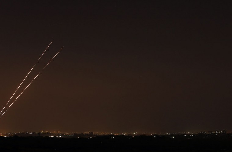 NOVEMBER 20: Rockets streaks are seen in the night sky after they are launched from the northern Gaza Strip towards Israel. (Yannis Behrakis/Reuters)
