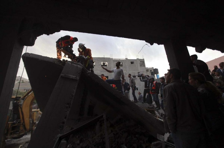 NOVEMBER 17 — Palestinians search for victims under the rubble of the destroyed house of a Hamas official after an Israeli air strike in Jabalya in the northern Gaza Strip November 17, 2012. I(Mohammed Salem/Reuters)