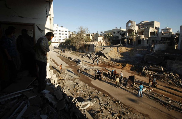 NOVEMBER 15 — A Palestinian man looks at the damage after Israeli air strikes in Gaza City November 15, 2012. (Suhaib Salem/Reuters)