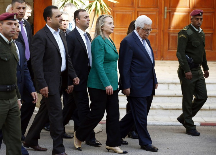 NOVEMBER 21: U.S. Secretary of State Hillary Clinton walks with Palestinian President Mahmoud Abbas (2nd R) after their meeting in the West Bank city of Ramallah. (Marko Djurica/Reuters)