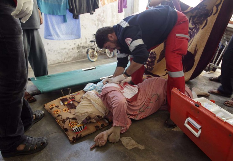 NOVEMBER 15 — A Palestinian medic tends to a wounded woman after an Israeli air strike in Khan Younis in the southern Gaza Strip November 15, 2012. (Ibraheem Abu Mustafa/Reuters)