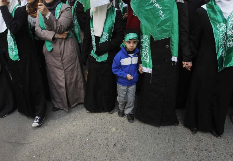 NOVEMBER 16 — Palestinians, with Hamas flags, take part in a demonstration in solidarity with Gaza and against Israel's military operation in the coastal enclave, in the West Bank city of Ramallah November 16, 2012. (Mohamad Torokman/Reuters)