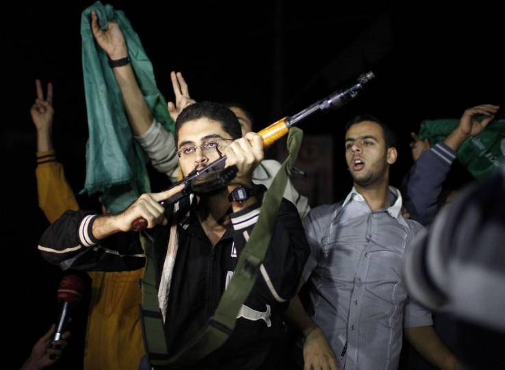 NOVEMBER 21: A Palestinian gunman kisses his rifle as he celebrates what he says is a victory over Israel after an eight-day conflict in Gaza City. (Ahmed Jadallah/Reuters)