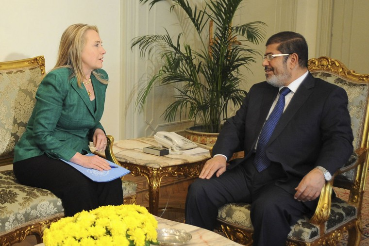 NOVEMBER 21: U.S. Secretary of State Hillary Clinton (L) and Egypt's President Mohamed Mursi meet at the presidential palace in Cairo. (Egyptian Presidency/Handout/Reuters)
