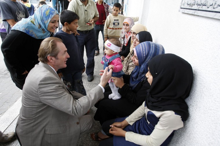 NOVEMBER 21: Director of the United Nations Relief and Works Agency (UNRWA) operations in Gaza Robert Turner speaks with displaced Palestinians, who fled from their houses, at a U.N.-run school in Gaza City. At least 50 Gaza families living next to the front line with Israel had fled their homes by the eighth day of Israel's air war but far more people will be uprooted if there is any ground invasion, the U.N. relief agency in the enclave said on Tuesday. (Ahmed Zakot/Reuters)