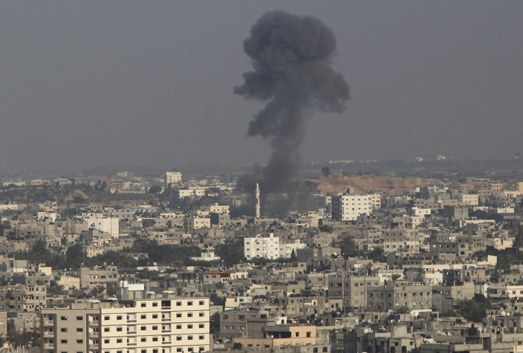 NOVEMBER 20: Smoke rises after what witnesses said was an Israeli air strike in the northern Gaza Strip. Talks between Israelis and Palestinians over a Gaza truce are continuing but the Egyptian mediators are still hopeful a deal can be reached later on Tuesday, an Egyptian official said. (Ali Hassan/Reuters)