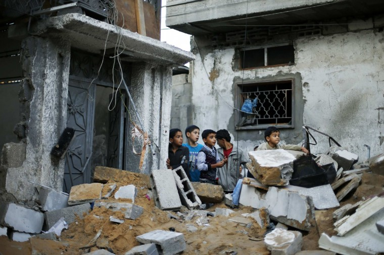 NOVEMBER 20: Palestinian boys stand next to the destroyed house of Hejazi family after what Hamas Health Ministry said was an Israeli air strike in the northern Gaza Strip. Four members of the same Hejazi family -- four-year-old twin boys and their parents -- were killed in the Israeli air strike in Gaza on Monday, the Hamas Health Ministry said. Israel had no immediate comment on the attack, one of more than 80 bombings during the day in the Hamas-ruled territory, where Israel launched an aerial offensive on Wednesday it says is intended to quell rocket fire at its cities. (Suhaib Salem/Reuters)