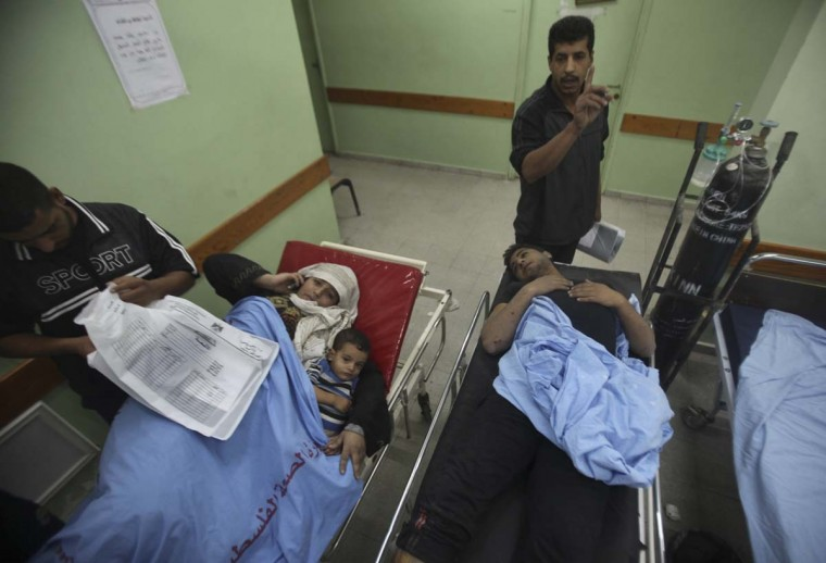 NOVEMBER 17 — Wounded Palestinians lie on hospital beds after an Israeli air strike in the northern Gaza Strip November 17, 2012. Israel's Cabinet authorised the mobilisation of up to 75,000 reservists, preparing the ground for a possible invasion into Gaza. (Ali Hassan/Reuters)