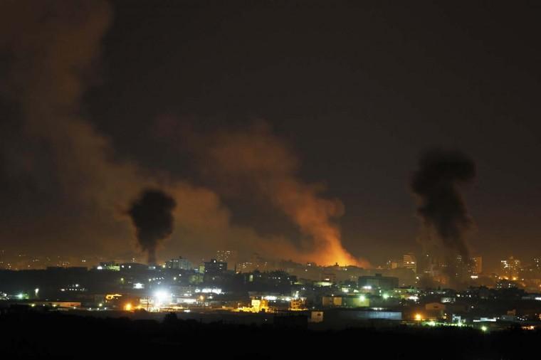 NOVEMBER 14 — Smoke rises after Israeli air strikes in the northern Gaza Strip November 14, 2012. (Darren Whiteside/Reuters)