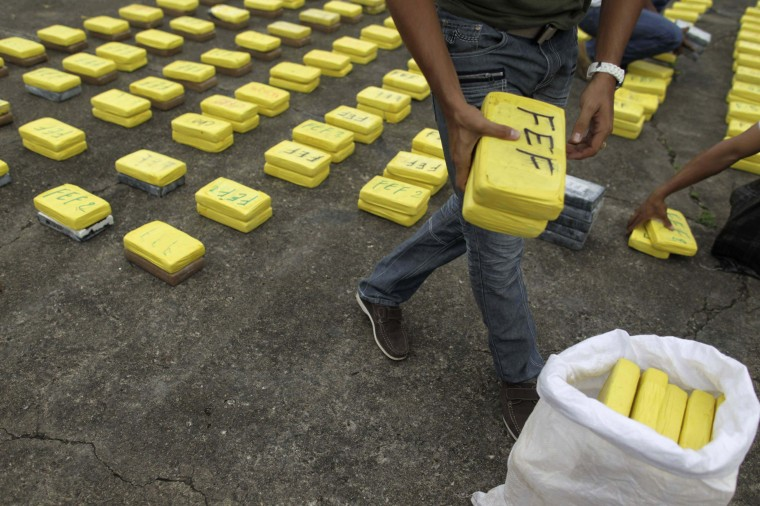 A member of the Air-Naval carries packages of seized cocaine during a drug presentation to the media at their base in Panama City November 8, 2012. The Panamanian Air-Naval police seized more than 441 kg (972 lbs) of cocaine found floating on the coast of Colon, 80 km (50 miles) from Panama City, according to Air-Naval officials. (Carlos Jasso/Reuters photo)